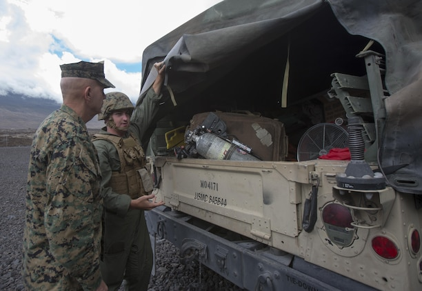 POHAKULOA TRAINING AREA, HAWAII – Sgt. Benjamin Alexander, an expeditionary fire/rescueman with Marine Wing Support Detachment 24, shows Lt. Gen David Berger, the commander of U.S. Marine Corps Forces, Pacific, the equipment used to extract an aircraft in the event of an emergency during his tour Exercise Bougainville II at Pohakuloa Training Area Aug. 21, 2017. Berger and a party of senior leadership met with junior Marines and leadership from various units taking part in the exercise, and observed day-to-day operations. Exercise Bougainville II prepares 3rd Battalion, 3rd Marine Regiment for service as a forward deployed force in the Pacific by training them to fight as a ground combat element in a Marine Air-Ground Task Force. (U.S. Marine Corps photo by Lance Cpl. Luke Kuennen)