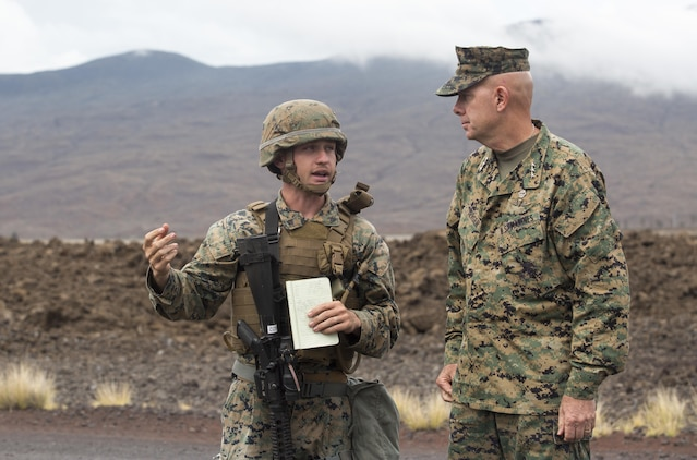 POHAKULOA TRAINING AREA, HAWAII – Cpl. Christian Warren, a bulk fuel specialist with Marine Wing Support Detachment 24, leads Lt. Gen. David Berger, the commander of U.S. Marine Corps Forces, Pacific, on a tour of the forward arming and refueling site for Exercise Bougainville at Pohakuloa Training Area Aug. 21, 2017. Berger and a party of senior leadership met with junior Marines and leadership from various units taking part in the exercise, and observed day-to-day operations. Exercise Bougainville II prepares 3rd Battalion, 3rd Marine Regiment for service as a forward deployed force in the Pacific by training them to fight as a ground combat element in a Marine Air-Ground Task Force. (U.S. Marine Corps photo by Lance Cpl. Luke Kuennen)