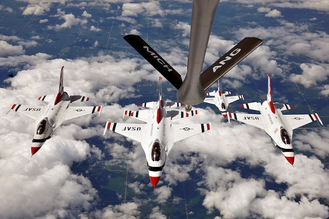 A KC-135 Stratotanker, from the 127th Wing Air Refueling Group, Selfridge Air National Guard Base Michigan, escorts five of the U.S. Air Force Thunderbirds F-16s from the 57th Wing, Nellis Air Force Base, Nevada, to perform at the Selfridge Centennial Open House and Air Show on Aug. 17, 2017.  The Thunderbirds are the U.S. Air Force's elite demonstration flying squadron, and will perform at the Selfridge Air Show on August 19th and 20th, 2017 in celebration of the base's 100 years of continuous flying operations.  (U.S. Air National Guard photo by MSgt. David Kujawa / Released)