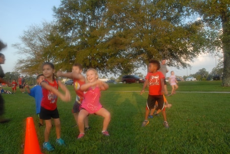 On August 18, 2017 MCES held its annual Kids Rock Day. The first event of the morning was a fartlek run and modified obstacle course. At each station along the fartlek course, a Marine demonstrated the exercise and the children mirrored the instructor.