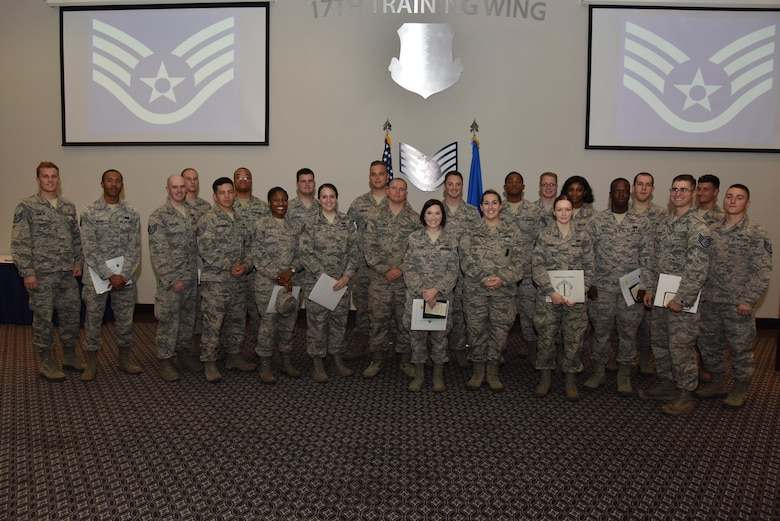 Senior airmen pose for a photo during the Staff Sergeant Release Party at the Event Center on Goodfellow Air Force Base, Texas, Aug. 24, 2017. The senior airmen will make the transition to staff sergeant though the course of the year. (U.S. Air Force photo by Staff Sgt. Joshua Edwards/Released)