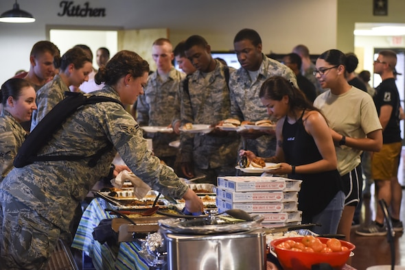 Airmen from various squadrons choose their food for the Airmen dorm dinner at the Crossroads on Goodfellow Air Force Base, Texas, Aug. 25, 2017. The free food was part of an event to show appreciation for Goodfellow students. (U.S. Air Force photo by Airman 1st Class Chase Sousa/Released)