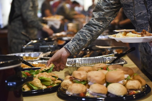 An Airman grabs food during the Airmen dorm dinner at the Crossroads on Goodfellow Air Force Base, Texas, Aug. 25, 2017. The event provided over 50 different food items including lunch, dinner and dessert options to show appreciation for Goodfellow students. (U.S. Air Force photo by Airman 1st Class Chase Sousa/Released)