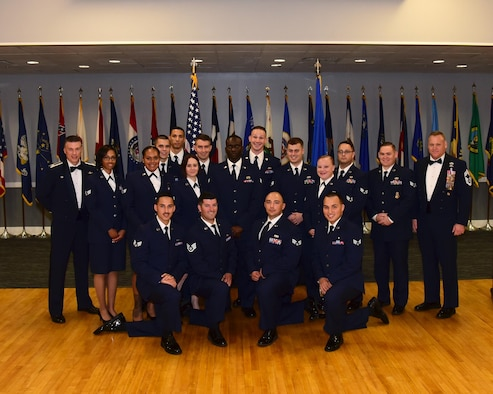 Airman Leadership School Class 17-6 stands with Col. Douglas Gosney, 14th Flying Training Wing Commander, and Chief Master Sgt. Brad Reilly, 14th Operations Group Superintendent, during the class's graduation Aug. 24, 2017, at the Columbus Club on Columbus Air Force Base, Mississippi. (U.S. Air Force photo by Elizabeth Owens)
