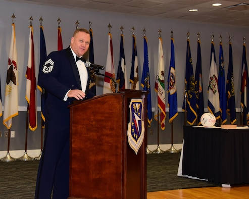 Chief Master Sgt. Brad Reilly, 14th Operations Group Superintendent, speaks at the Airman Leadership School Class 17-6 graduation Aug. 24, 2017, at the Columbus Club on Columbus Air Force Base, Mississippi. Reilly, the guest speaker, likened the process of sword-making into building a great Airman during his speech. (U.S. Air Force photo by Elizabeth Owens)