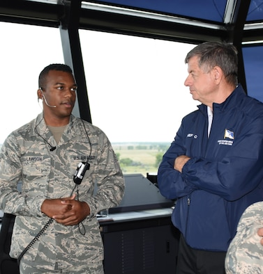 The 11th Chief Master Sergeant of the Air Force, retired, David J. Campanale, is briefed on air traffic control procedures by Airman 1st Class Horace Lawson, 319th Operations Support Squadron air traffic controller, during a visit to the base Aug. 25, 2017, at Grand Forks Air Force Base, N.D. Following his tour of the base, Campanale was the guest speaker at this year's Senior NCO induction ceremony. (U.S. Air Force photo by Senior Airman Cierra Presentado)