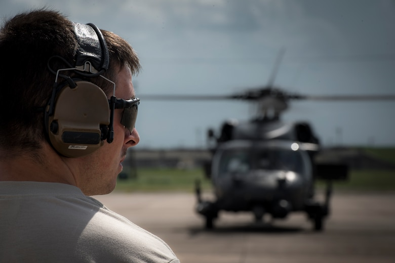 A maintainer from the 41st Helicopter Maintenance Unit marshals an HH-60G Pave Hawk prior to a sortie in support of Hurricane Harvey relief efforts, Aug. 28, 2017, at Naval Air Station Fort Worth Joint Reserve Base, Texas. The 347th Rescue Group from Moody Air Force Base, Ga. sent aircraft and personnel in support of Air Forces Northern as part of Northern Command's support of FEMA's disaster response efforts. (U.S. Air Force photo by Staff Sgt. Ryan Callaghan)