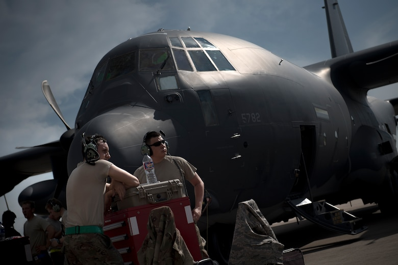 Maintainers from the 71st Aircraft Maintenance Unit standby outside an HC-130J Combat King II prior to a sortie in support of Hurricane Harvey relief efforts, Aug. 28, 2017, at Naval Air Station Fort Worth Joint Reserve Base, Texas. The 347th Rescue Group from Moody Air Force Base, Ga. sent aircraft and personnel in support of Air Forces Northern as part of Northern Command's support of FEMA's disaster response efforts. (U.S. Air Force photo by Staff Sgt. Ryan Callaghan)