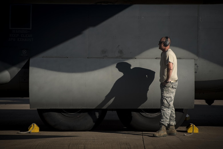 A maintainer from the 71st Aircraft Maintenance Unit waits to pull chocks from under an HC-130J Combat King II prior to a sortie in support of Hurricane Harvey relief efforts, Aug. 28, 2017, at Naval Air Station Fort Worth Joint Reserve Base, Texas. The 347th Rescue Group from Moody Air Force Base, Ga. sent aircraft and personnel in support of Air Forces Northern as part of Northern Command's support of FEMA's disaster response efforts. (U.S. Air Force photo by Staff Sgt. Ryan Callaghan)