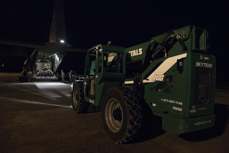 A forklift prepares to unload an HC-130J Combat King II, Aug. 28, at Easterwood Airport in College Station, Texas. The 347th Rescue Group from Moody Air Force Base, Ga. sent aircraft and personnel in support of Air Forces Northern as part of Northern Command's support of FEMA's disaster response efforts. (U.S. Air Force photo by Tech. Sgt. Zachary Wolf)