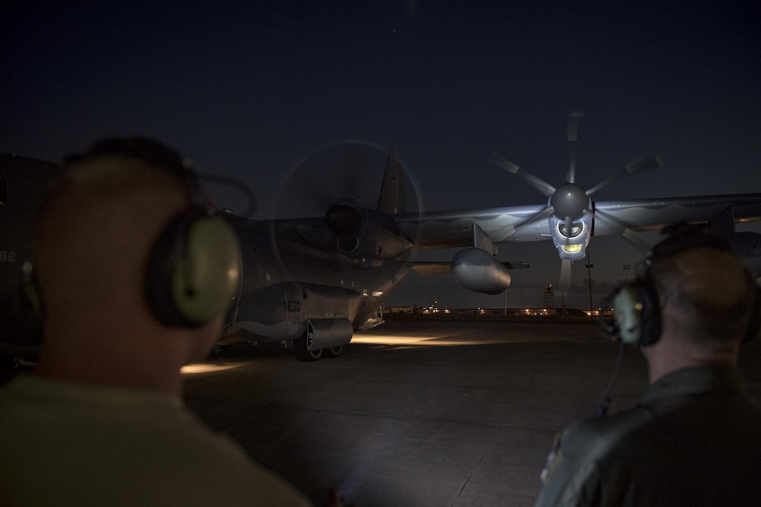 Maintainers and aircrew inspect an HC-130J Combat King II prior to a sortie in support of Hurricane Harvey relief efforts, Aug. 28, 2017, at Naval Air Station Fort Worth Joint Reserve Base, Texas. The 347th Rescue Group from Moody Air Force Base, Ga. sent aircraft and personnel in support of Air Forces Northern as part of Northern Command's support of FEMA's disaster response efforts. (U.S. Air Force photo by Staff Sgt. Ryan Callaghan)