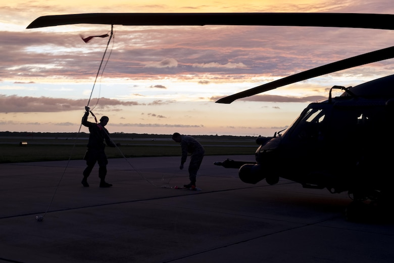 Airmen from the 41st Helicopter Maintenance Unit secure a rotor blade, Aug. 28, 2017, at Easterwood Airport in College Station, Texas. The 347th Rescue Group from Moody Air Force Base, Ga. sent aircraft and in support of Air Forces Northern as part of Northern Command's support of FEMA's disaster response efforts. (U.S. Air Force photo by Tech. Sgt. Zachary Wolf)