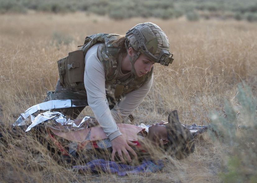 Airman 1st Class  Melea Lynn, 366th Civil Engineer Squadron explosive ordinance disposal technician tends to an injured party during an exercise August 24, 2017, at Orchard training area, Idaho. EOD trains in medical care to stabilize victims of explosions until a paramedic can take over treatment. (U.S. Air Force photo by Airman 1st Class Jeremy D. Wolff/Released)