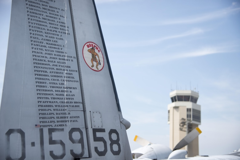 "The ""Flying POW/MIA"" monument, Grumman OV-1 Mohawk, sits during the 2017 Thunder Over Dover Open House Aug. 27, 2017, on Dover Air Force Base, Del. There are 1,636 names on the aircraft and some have small flags to indicate a repatriated Vietnam War service member. (U.S. Air Force photo by Staff Sgt. Jared Duhon)"