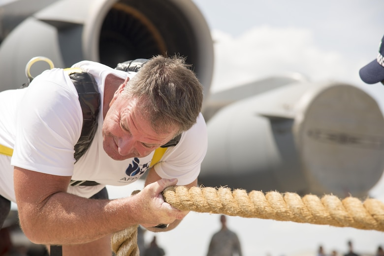 Cmdr. Grant Edwards, Australian Federal Police, Embassy of Australia, Washington, D.C., pulls  a C-17 Globemaster III during the 2017 Thunder Over Dover Open House Aug. 27, 2017, on Dover Air Force Base, Del. The aircraft weights more than 282,000 pounds. (U.S. Air Force photo by Staff Sgt. Jared Duhon)