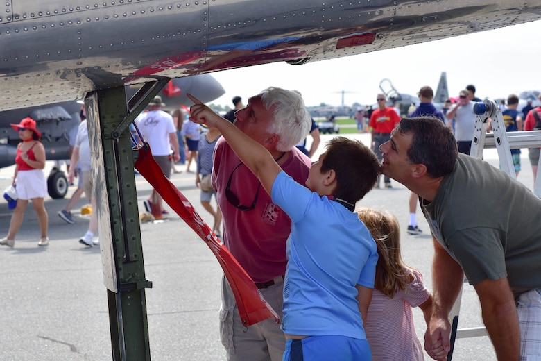 A family looks inside a static display during the 2017 Thunder Over Dover Open House Aug. 25, 2017, on Dover Air Force Base, Del. The open house and airshow featured performances from the U.S. Air Force Thunderbirds, the U.S. Army's Black Daggers parachute team and several other aerial performers. (U.S. Air Force photo by Staff Sgt. Richard Mekkri)