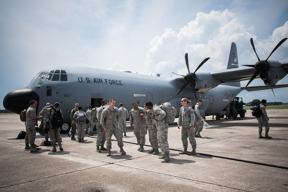 Members of the 403rd Wing exit an 815th Airlift Squadron C-130J Super Hercules aircraft upon their return from exercise Patriot Warrior Aug. 23, 2017 at Keesler Air Force Base, Mississippi. (U.S. Air Force photo/Staff Sgt. Heather Heiney)