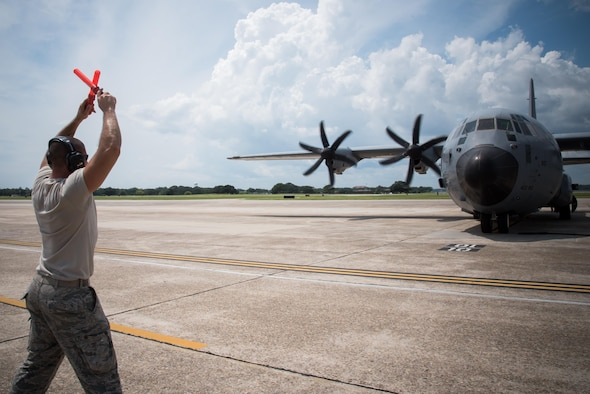 A member of the 803rd Aircraft Maintenance Squadron marshals in an 815th Airlift Squadron C-130J Super Hercules aircraft upon its return from exercise Patriot Warrior Aug. 23, 2017 at Keesler Air Force Base, Mississippi. (U.S. Air Force photo/Staff Sgt. Heather Heiney)