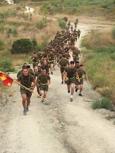 Bravo Company Conducts early morning PT to the top of cardiac hill during the company run.