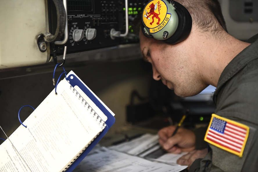Tech. Sgt. Joe Joiner, 16th Airlift Squadron loadmaster, goes over a pre-flight checklist before flying a mission Aug. 29 to provide disaster relief to those impacted by Hurricane Harvey.