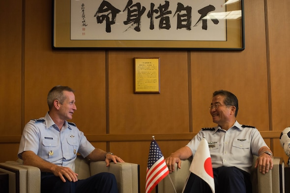 U.S. Air Force Gen. Terrence J. O'Shaughnessy, Pacific Air Forces commander, shakes hands with Lt. Gen. Jerry P. Martinez, U.S. Forces Japan and 5th Air Force commander, Aug. 30, 2017, at Yokota Air Base, Japan. O'Shaughnessy's visit was to reaffirm the strength of the partnership between the U.S. Air Force and the Japan Air Self-Defense Force. (U.S. Air Force photo by Airman 1st Class Kevin West)