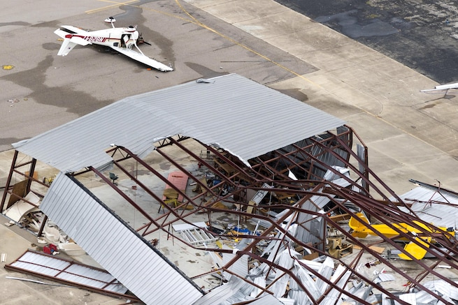 An aerial view showing the massive devastation to an airplane hangar caused by Hurricane Harvey
