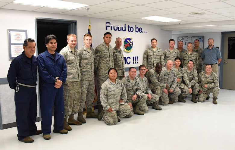 Maj. Gen. Christopher Bence, commander, USAF Expeditionary Center and Command Chief Master Sgt. Larry Williams, USAF EC command chief, pose with Airmen with the 733rd Air Mobility Squadron at Kadena Air Base, Japan, Aug. 21, 2017.  Bence and Williams along with the 515th Air Mobility Operations Wing leadership team visited three air mobility squadrons of the 515th AMOW in Japan and South Korea. (U.S. Air Force photo by Tech. Sgt. Jamie Powell)