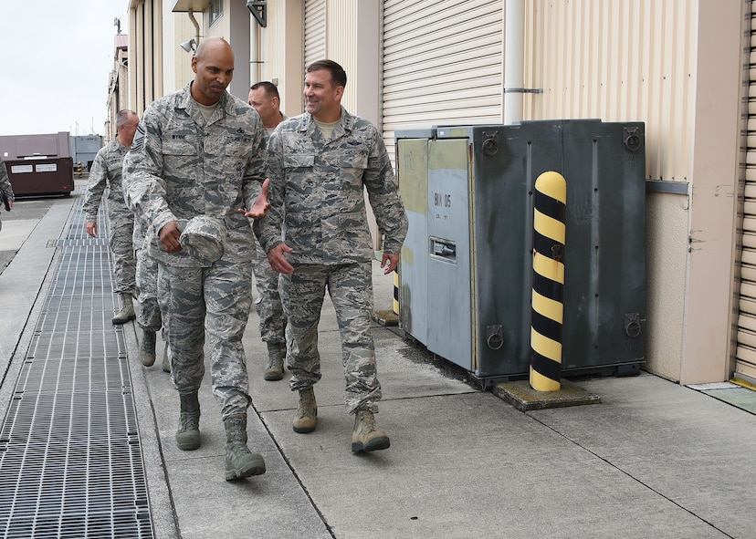 Maj. Gen. Christopher Bence, (right) commander, USAF Expeditionary Center, walks with Senior Master Sgt. Michael Wynne, 730th Air Mobility Squadron maintenance superintendent, while touring the 730th AMS maintenance flight at Yokota Air Base, Japan, Aug. 21, 2017.  Bence, along with Command Chief Master Sgt. Larry Williams, USAF EC command chief, and the 515th Air Mobility Operations Wing leadership team visited three air mobility squadrons of the 515th AMOW in Japan and South Korea. (U.S. Air Force photo by Tech. Sgt. Jamie Powell)