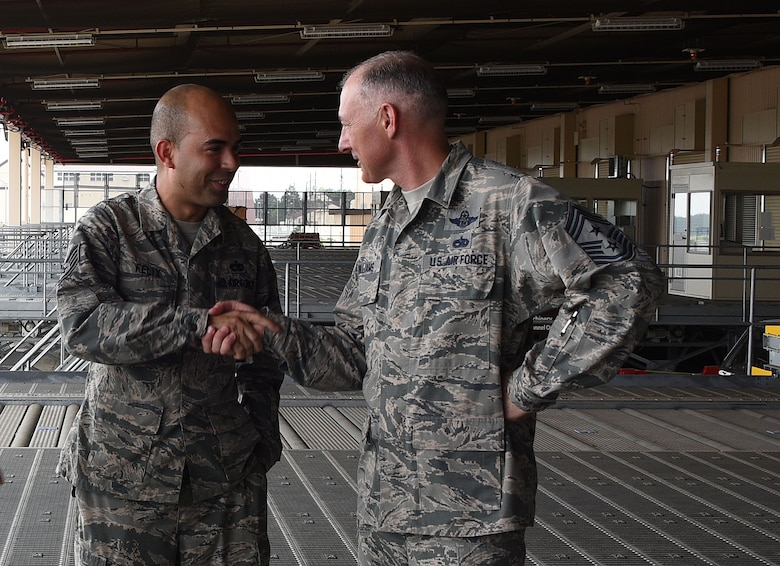 Command Chief Master Sgt. Larry Williams (right), USAF Expeditionary Center command chief, greets Staff Sgt. Anthony Felix with the 730th Air Mobility Squadron, while visiting Yokota Air Base, Japan, Aug. 21, 2017. Williams along with Maj. Gen. Christopher Bence, USAF EC commander, visited three air mobility squadrons of the 515th Air Mobility Operations Wing in Japan and South Korea. (U.S. Air Force photo by Tech. Sgt. Jamie Powell)