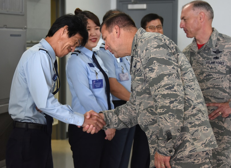 Maj. Gen. Christopher Bence, commander, USAF Expeditionary Center and Command Chief Master Sgt. Larry Williams, USAF EC command chief, greet Republic of Korea air force airmen while at Osan Air Base, Republic of Korea, Aug. 25, 2017. Bence and Williams along with the 515th Air Mobility Operations Wing leadership team visited three air mobility squadrons of the 515th AMOW in Japan and Republic of Korea. (U.S. Air Force photo by Tech. Sgt. Jamie Powell)