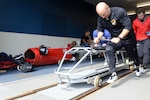 Army Sgt. Nick Cunningham, a bobsled driver for the U.S. Men's Bobsled National Team and soldier in the New York Army National Guard, pushes a modified bobsled during practice at Lake Placid, N.Y., Aug. 23, 2017. DoD photo by David Vergun