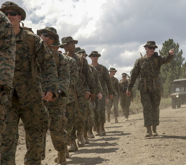 1st Sgt. Joshua Brown, company first sergeant of 2nd Law Enforcement Battalion Headquarters Group, motivates Marines during a conditioning hike as part of the Mountain Warfare Training exercise in Bridgeport, Calif., Aug. 22, 2017.