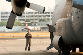 Airmen perform final flight checks on an aircraft.
