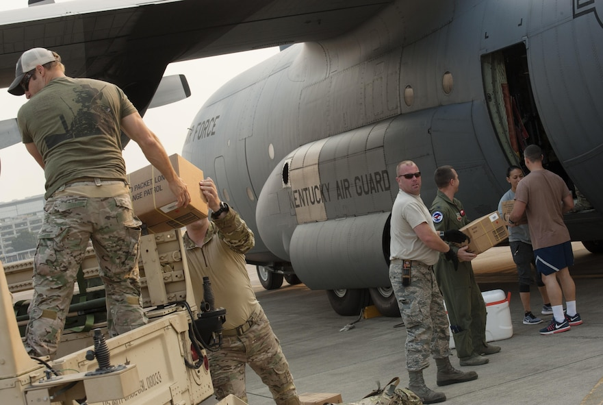 Oregon Air National Guardsmen from the 125th Special Tactics Squadron pack food and equipment aboard a C-130 Hercules assigned to the 123rd Airlift Wing, Kentucky Air National Guard, as they prepare to leave the Portland Air National Guard Base, Ore., Aug. 29, 2017. Approximately 17 Oregon from the 125th Special Tactics Squadron will also be joined by 3 members of the Air Force Reserve 304th Rescue Squadron, as they travel to Ellington Field Joint Reserve Base, Houston, Texas. (U.S. Air National Guard photo/Master Sgt. John Hughel, 142nd Fighter Wing Public Affairs)