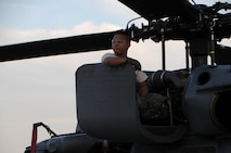 Air Force Senior Airman Ray-Christian Demafiles, a crew chief with the 106th Rescue Wing assigned to the New York Air National Guard, seated on top of an HH-60 Pavehawk helicopter engine cowling at Fort Hood, Texas August 28, 2017. The Pavehawk had returned from the day's mission that helped save 255 people and two dogs. (U.S. Air National Guard photo by Daniel H. Farrell)