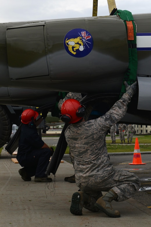 The 3rd Maintenance Squadron crash recovery team and 773d Civil Engineer Squadron structure shop return the newly refurbished Lockheed P-38 Lightning to the 3rd Wing at Joint Base Elmendorf-Richardson, Alaska, Aug. 26, 2017. The aircraft has been a static display at JBER since May of 2000 as a reminder of the sacrifices made in the 'Forgotten War' of the Aleutian Island chain; the restoration program started in August of 2016.