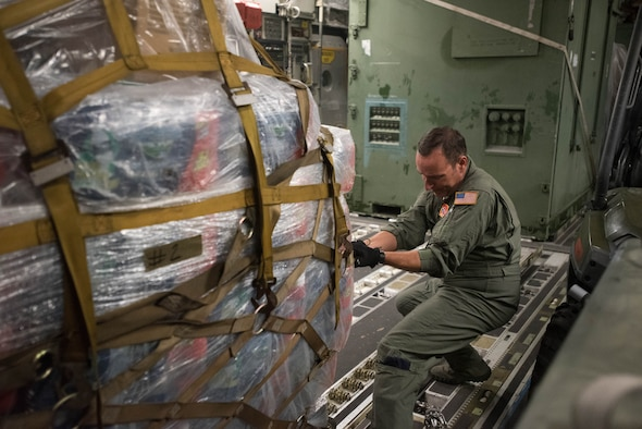 Master Sgt. Jesse Spainhour, a crew chief from the Tennessee Air Guard, pulls a pallet of equipment from the Kentucky Air Guard's 123rd Contingency Response Group onto a C-17 Globemaster III at the Kentucky Air National Guard Base in Louisville, Kentucky, Aug. 29, 2017 in preparation for Hurricane Harvey rescue efforts in Texas. More than 40 Airmen from the Kentucky and Mississippi Air National Guard are deploying to George Bush Intercontinental Airport in Houston, where they will rapidly establish airfield, aeromedical evacuation and cargo operations. (U.S. Air National Guard  photo by Master Sgt. Phil Speck)