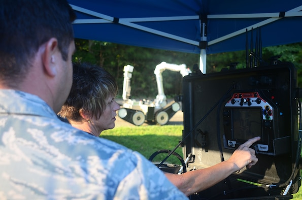 A contractor points at the camera display of an explosive ordnance disposal robot during a training scenario at this year's Eastern National Robot Rodeo at Dobbins Air Reserve Base, Ga. Aug. 22, 2017. Each training scenario began with contractors reviewing robot controls with EOD teams competing in the event. (U.S. Air Force photo/Don Peek)