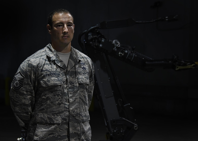 Master Sgt. Richard Swann, 94th explosive ordnance disposal flight operations section chief, poses for a photo in front of an EOD robot in a hangar at Hartsfield Jackson International Airport, Atlanta on Aug. 23, 2017. Swann helped coordinate this year's Eastern Robot Rodeo, hosted at Dobbins Air Reserve Base, Ga. (U.S. Air Force photo/Staff Sgt. Miles Wilson)