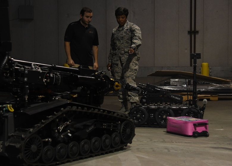 Col. Tanya Anderson, Air Force Civil Engineer Center Readiness Director at Tyndall Air Force Base, Fla., observes several explosive ordnance disposal robots at Dobbins Air Reserve Base, Ga, August 23, 2017. The robots were brought to Dobbins during an EOD Rodeo, and were used during several exercises between joint, community and coalition partners. (U.S. Air Force Photo/Staff Sgt. Miles Wilson)