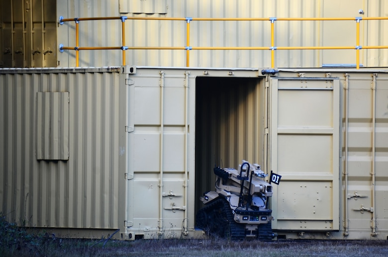 An explosive ordnance disposal robot enters a shipping container during this year's Eastern Robot Rodeo at Dobbins Air Reserve Base, Ga. Aug. 24, 2017. The Robot Rodeo included seven different training scenarios throughout the week-long event, with each scenario relying on different sized robots and techniques for completing the mission. (U.S. Air Force photo/Don Peek)