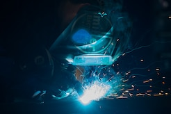 U.S. Air Force Airman 1st Class Jordan Mann, 1st Maintenance Squadron metals technology journeyman, welds a piece of metal at Joint Base Langley-Eustis, Va., Aug. 17, 2017. The job of a 1st MXS metals technicians is to provide support for the flightline by fixing basic and major aircraft damages through metal work. (U.S. Air Force photo by Senior Airman Derek Seifert)
