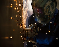 """U.S. Air Force Airman 1st Class David Norgaard, 1st Maintenance Squadron metals technology apprentice, removes a piece of metal at the metals technology shop at Joint Base Langley-Eustis, Va., Aug. 17, 2017. """"Measure twice, cut once"""" is the moto that metal technicians operate by to ensure the accuracy and precision of their work. (U.S. Air Force photo by Senior Airman Derek Seifert)"""