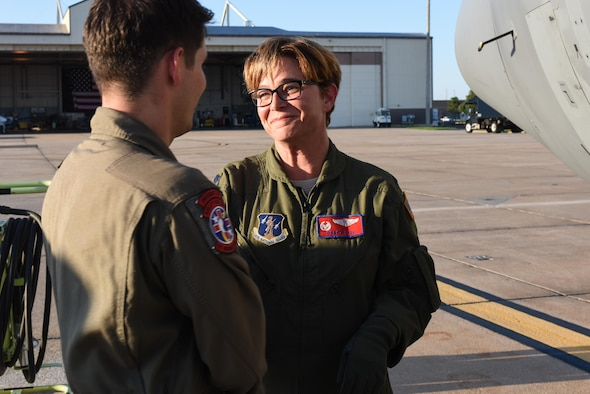Lt. Col. Darcy Tate, 137th Aeromedical Evacuation Squadron commander, wishes members from her squadron farewell as they board a C-130 Hercules from the 136th Airlift Wing, Naval Air Station Fort Worth Joint Reserve Base at Carswell Field, Texas, Aug. 29, 2017, at Will Rogers Air National Guard Base. The Airmen are part of the 137th Special Operation Wing's deployment of about 40 medical and aeromedical evacuation Airmen and equipment in support of the Texas Military Department and their relief efforts following Hurricane Harvey. (U.S. Air National Guard photo by Staff Sgt. Kasey Phipps/Released)