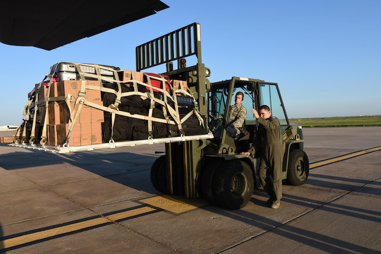 Senior Airman Benjamin Anderson, a 137 SOLRS small air terminal specialist, from Will Rogers Air National Guard Base in Oklahoma City, receives direction from a loadmaster from the 136th Airlift Wing, located at Naval Air Station Fort Worth Joint Reserve Base at Carswell Field, Texas, while loading a pallet of medical equipment and supplies onto a C-130 Hercules from the 136 AW, Aug. 28, 2017, at Will Rogers Air National Guard Base. The 137th Special Operations Wing deployed about 40 medical and aeromedical evacuation Airmen and equipment in support of the Texas Military Department and their relief efforts following Hurricane Harvey. (U.S. Air National Guard photo by Staff Sgt. Kasey Phipps/Released)