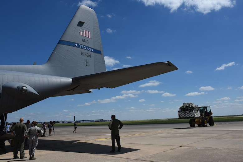 Airmen from the 137th Special Operations Wing, Will Rogers Air National Guard Base, Oklahoma City, and the 136th Airlift Wing from Naval Air Station Fort Worth Joint Reserve Base at Carswell Field, Texas, wait as a second pallet of medical equipment and supplies from the 137th is loaded onto a C-130 Hercules from the 136th, Aug. 28, 2017, at Will Rogers Air National Guard Base. The 137th Special Operations Wing deployed nearly 40 medical and aeromedical evacuation Airmen and equipment in support of the Texas Military Department and their relief efforts following Hurricane Harvey. (U.S. Air National Guard photo by Staff Sgt. Kasey Phipps/Released)