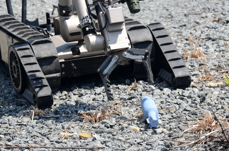 An explosive ordnance disposal robot reaches for a simulated explosive device during this year's Eastern National Robot Rodeo at Dobbins Air Reserve Base, Ga. Aug. 21, 2017. In designing the different training scenarios for the event, evaluators relied on a variety of locations both on and off base to provide realistic situations for testing the robots' capabilities. (U.S. Air Force photo/Don Peek)