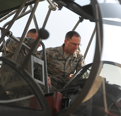 Chief Master Sgt. Stanley Cadell, 25th Air Force command chief, observes instruments of a U-2 Dragon Lady training aircraft.