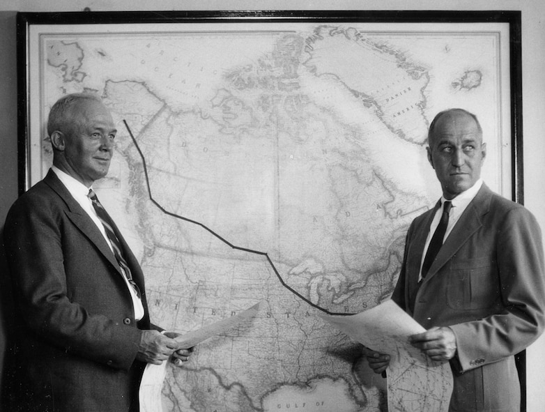Lt. Col. H.H. Arnold, Commanding Officer of Alaskan Flight and Maj. Ralph Royce, Operations Officer studying maps that will guide flight to Alaska.