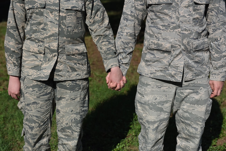 Illustration photo of a military couple holding hands.